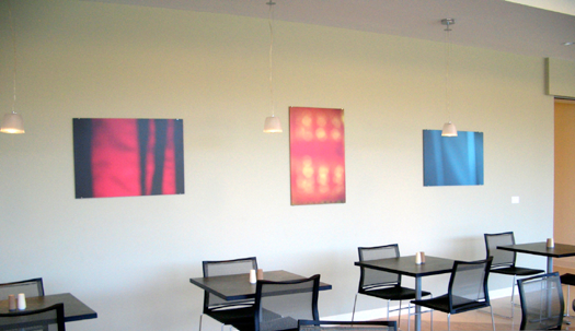 3 abstract photographs hanging on wall of meeting space